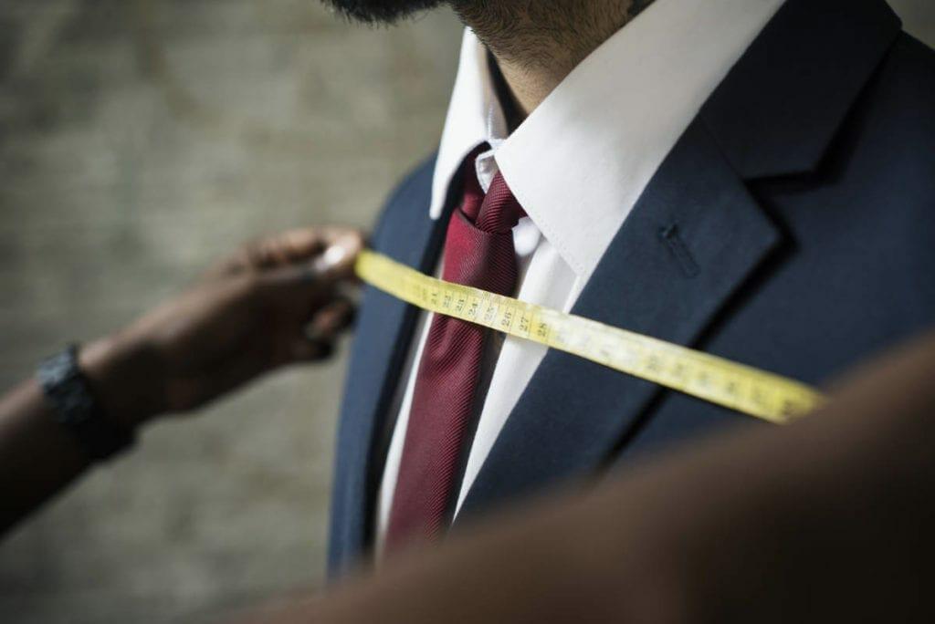 classy man tailor measuring